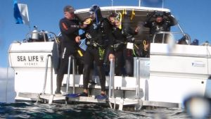 An advanced student learning about diving from a boat